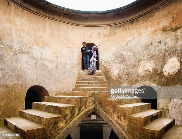 Tourists visiting the old water palace in Yogyakarta Indonesia