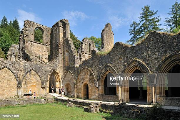 Tourists visiting the Orval Abbey / Abbaye NotreDame d'Orval a Cistercian monastery founded in 1132 at VillersdevantOrval Florenville Belgian...