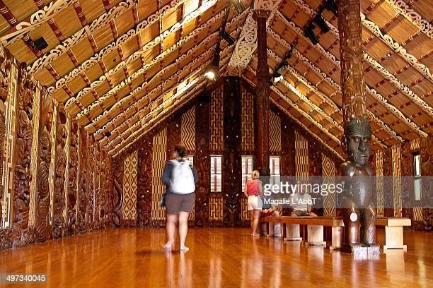 Tourists visiting Whare Runanga the beautifully carved meeting house at the Waitangi Treaty Grounds Paihia Bay of Islands