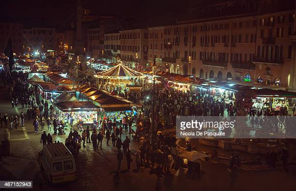 Tourists visting the Christmas Market in Navona Square in Rome. Christmas Markets in Italy are popular both with the locals and visitors from Europe...
