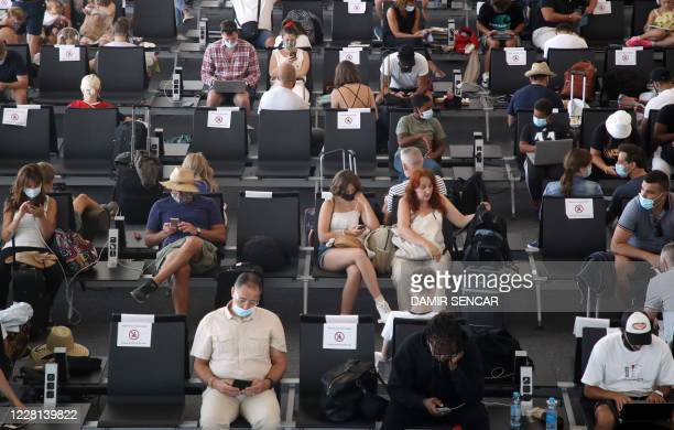 """Tourists wait at Split International Airport in Split, Croatia, on August 21, 2020. - As United Kingdom removed Croatia from the list of """"safe..."""