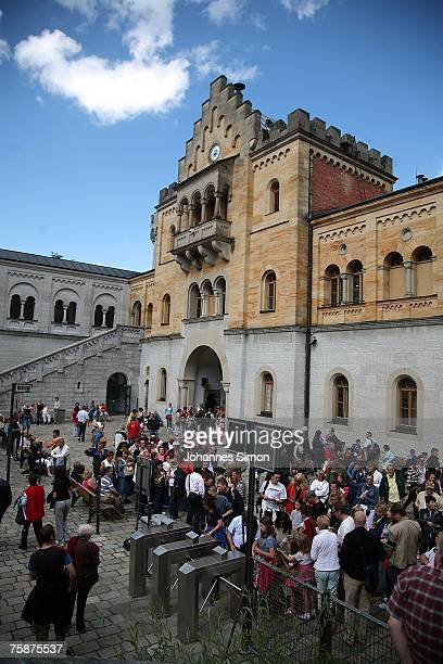Tourists wait for a guided tour in the front court of the castle Neuschwanstein built by Bavarian King Ludwig II on July 30 2007 in Schwangau Germany...