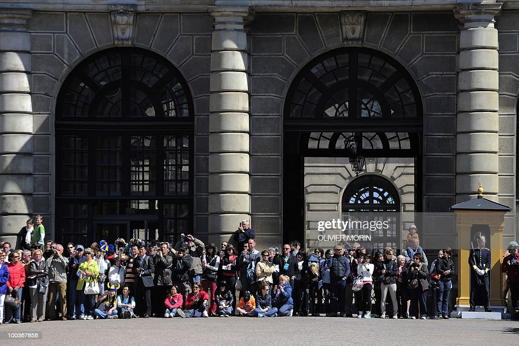 Tourists wait for the changing of the guard in front of the Royal Castle in Stockholm on May 24, 2010. Many tourists paid a visit to the Swedish capital less than a month before Crown Princess Victoria 's wedding, the 32-year-old eldest daughter of King Carl XVI Gustaf.