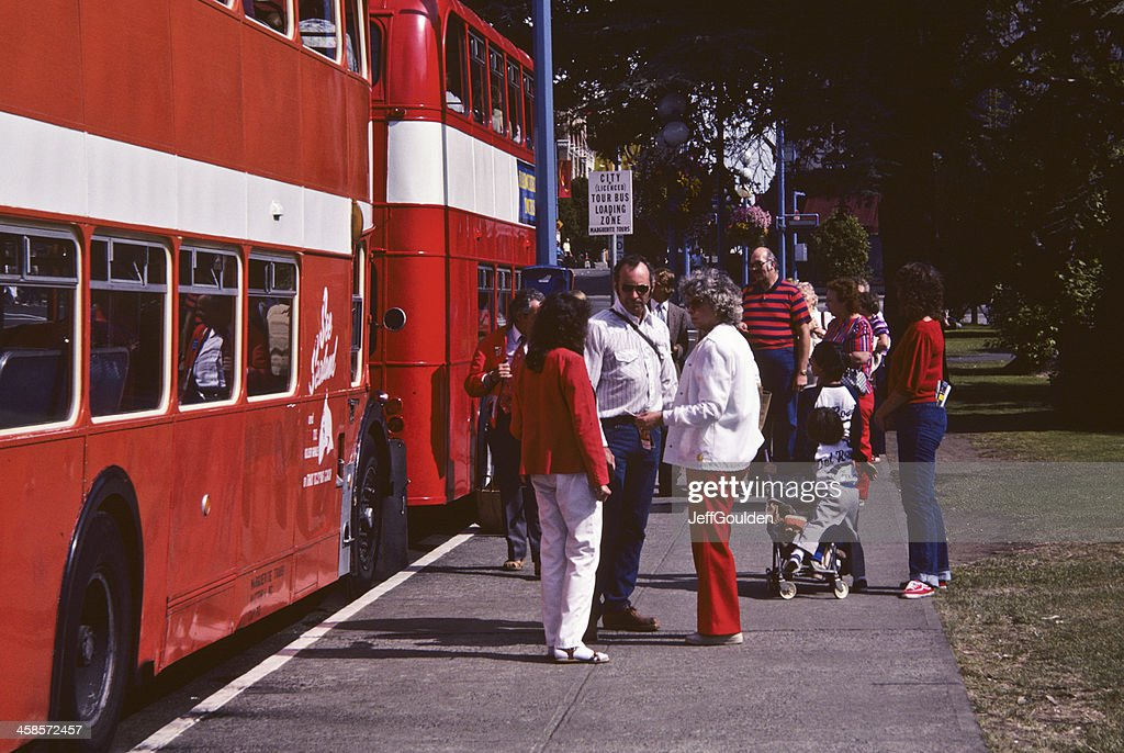 Tourists Waiting for the Double Decker Bus : Stock Photo