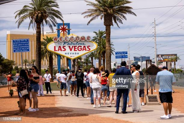"""Tourists wait in line to take photographs with the """"Welcome to Fabulous Las Vegas"""" sign in Las Vegas, Nevada, U.S., on Saturday, May 1, 2020. Anthony..."""