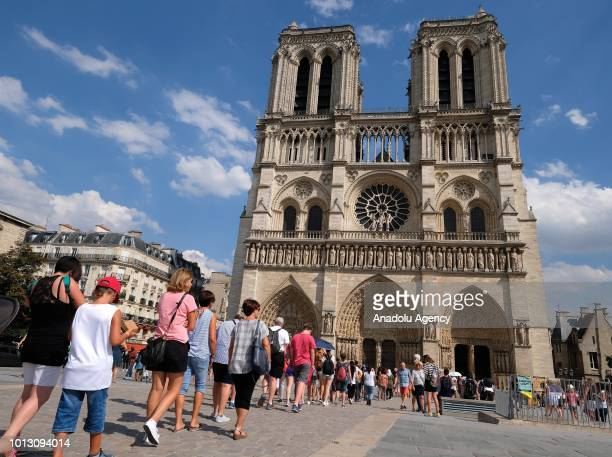 Tourists wait in the queue for enter to Notre-Dame Cathedral in Paris, France on August 08, 2018.