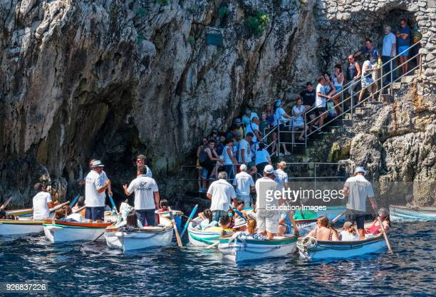 Tourists Waiting In Turn To Enter The Blue Grotto On The Island Of Capri, Italy.
