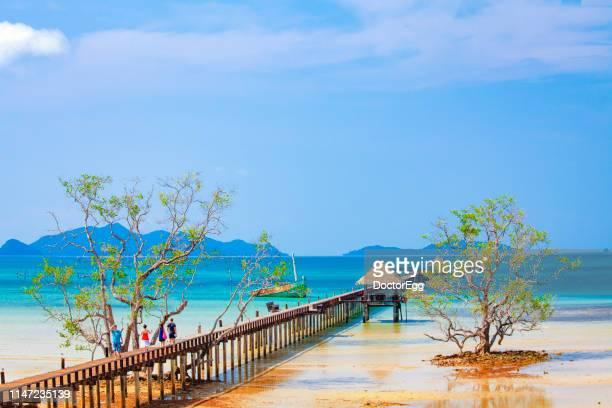 Tourists waling along Pier Bridge at Koh Mak Island, Trat, Thailand