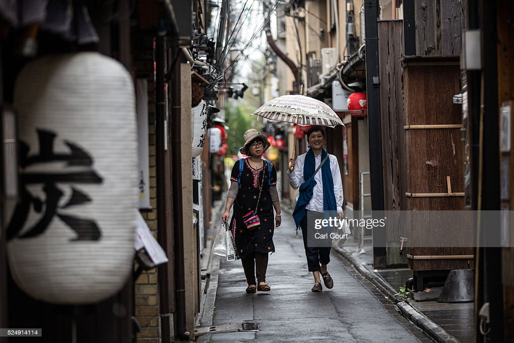 Tourists walk along a narrow lane on April 27, 2016 in Kyoto, Japan. Now the seventh largest city in Japan, Kyoto was once the Imperial capital for more than one thousand years, it is now the capital city of Kyoto Prefecture and a major part of the Kyoto-Osaka-Kobe metropolitan area.