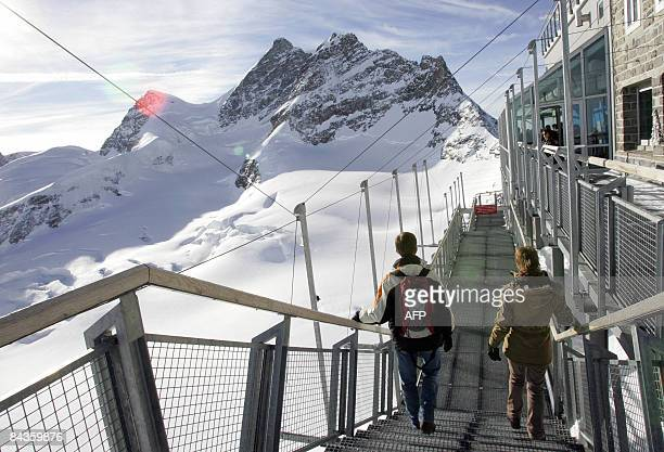 Tourists walk along a viewing deck at the Jungfraujoch observator at an altitude of 3454 meters on January 16 2009 The Jungrau is one of...