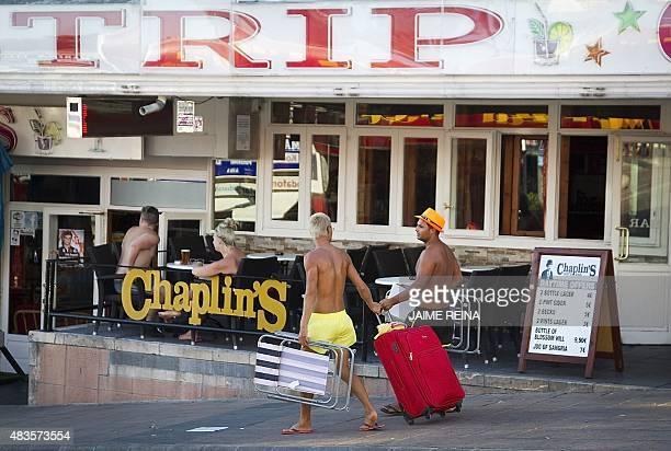 Tourists walk along Punta Ballena street in Magaluf Calvia on Mallorca Island on August 10 2015 AFP PHOTO/ JAIME REINA