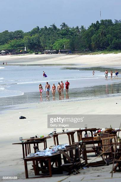 Tourists walk along the beach towards the Jimbaran Fish Cafes the morning after they were bombed on October 2 2005 in Bali Indonesia Three bomb...