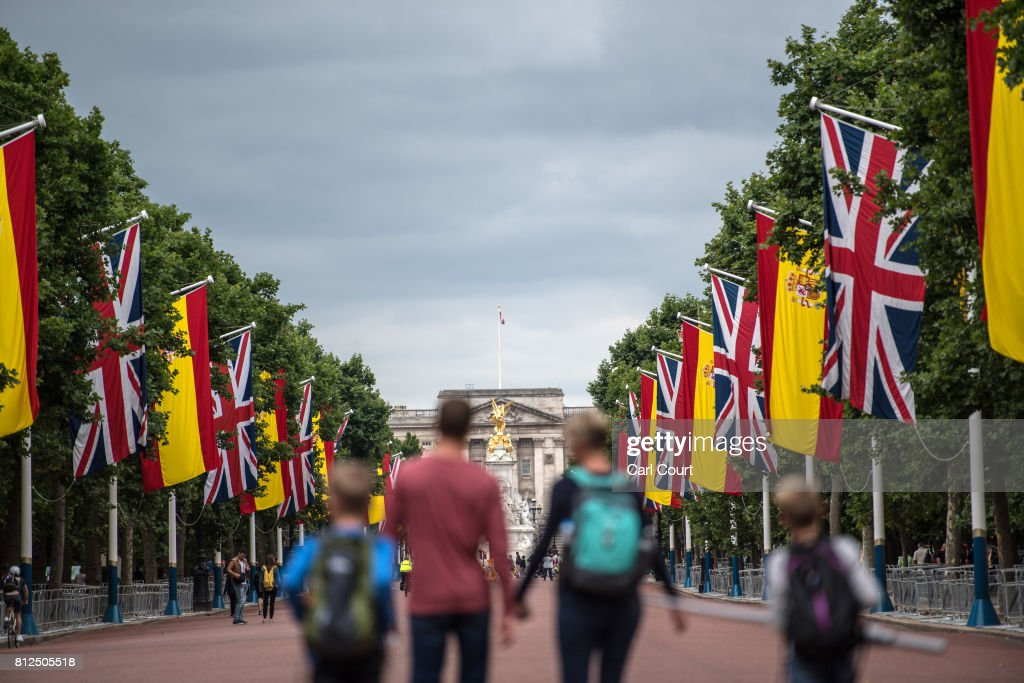 Tourists walk along The Mall where Spanish flags have been hung alongside Union Flags ahead of the state visit by King Felipe and Queen Letizia of Spain, on July 11, 2017 in London, England. The visit was originally planned from 6th to 8th June but was postponed and will now take place on 12th to 14th July 2017.