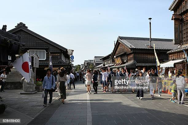 Tourists walk along the Okage Yokocho, a traditional shopping street on May 5, 2016 in Ise, Japan. Ise-Shima prepares for the G7 summit which is to...