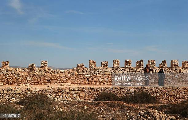 Tourists walk along the walls of the original Kasbah which was built in 1572 on December 9 2013 in Agadir Morocco The Kasbah was partly restored...