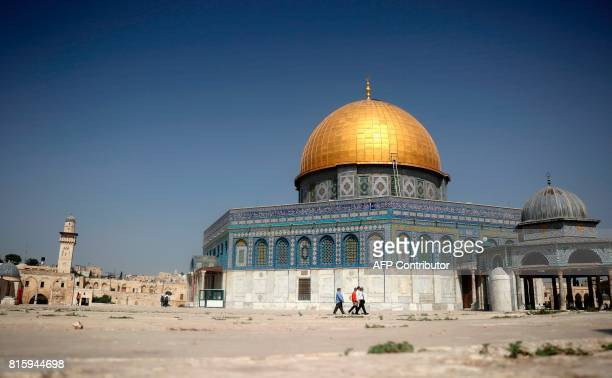 Tourists walk around the Dome of the Rock in the AlAqsa Mosque compound in the old city of Jerusalem on July 17 after Palestinian Muslim worshippers...