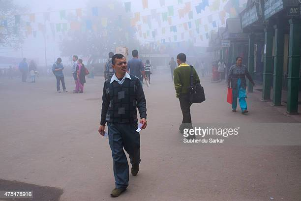 Tourists walk at Chowrasta mall in Darjeeling in a misty morning Darjeeling is a town in India's West Bengal state in the Himalayan foothills Once a...