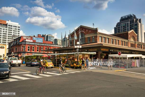 tourists walk by food stalls in the byward market area of ottawa canada - downtown stock pictures, royalty-free photos & images
