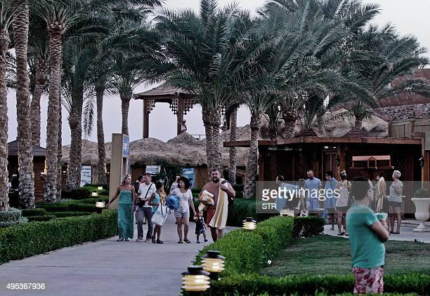 Tourists walk in a beach complex at Egyptian Red Sea resort of Sharm elSheikh on November 2 2015 A Russian passenger plane carrying 224 people and...