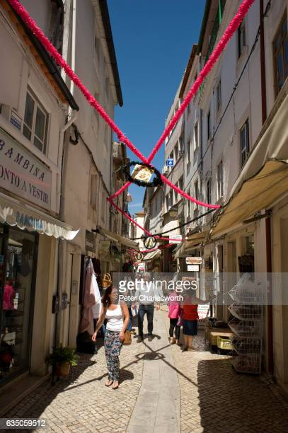 Tourists walk in a narrow pedestrians only walking street in the center of this old university town Many of the small squares and alleyways in this...
