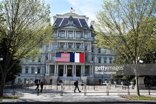 Tourists walk in front of the Eisenhower Executive Office Building next to the White House on Pennsylnavia Avenue in Washington DC The American and...