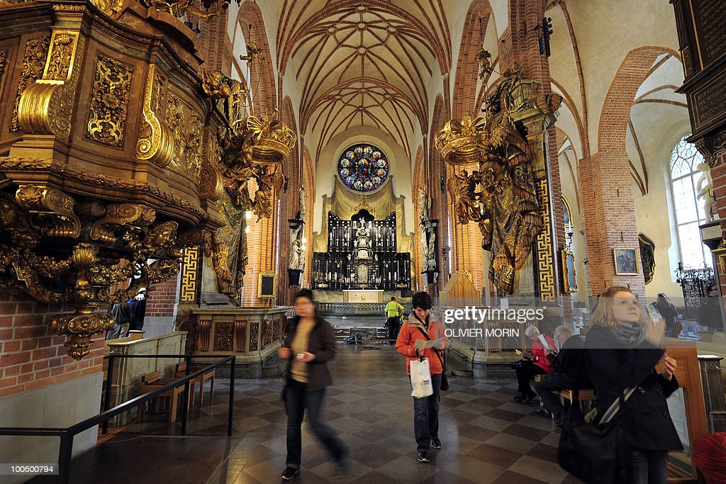 Tourists walk in the Cathedral, known as Storkyrkan, situated near the Royal Castle in Stockholm on May 25, 2010, less than a month before Crown Princess Victoria 's wedding, the 32-year-old eldest daughter of King Carl XVI Gustaf. Tensions with the archbishop, the future prince's health problems and the soaring cost of the festivities are just some of the controversies surrounding the run-up to Swedish Crown Princess Victoria and her husband-to-be Daniel Westling's June 19 wedding.