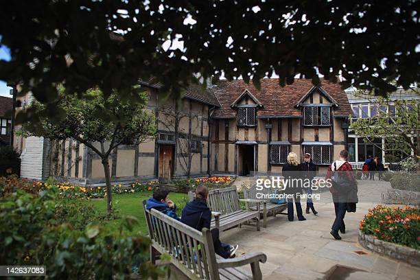 Tourists walk in the gradens of William Shakespeare's birthplace on April 10 2012 in StratfordUponAvon England With only a few months to go until the...