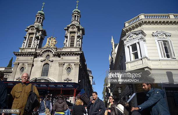 Tourists walk in the streets of San Telmo neighborhood in Buenos Aires Argentina on June 14 2015 San Telmo is one of the oldest neighborhoods of the...