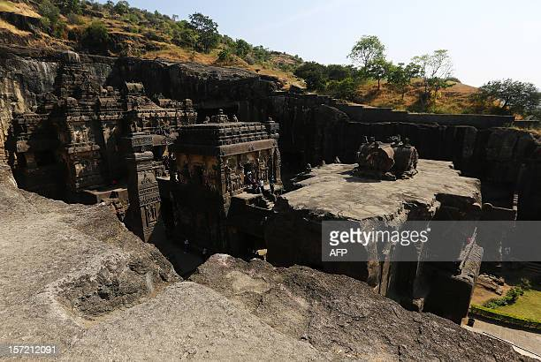 Tourists walk inside a large Hindu stone structure at The Ellora Caves in the western Indian state of Maharashtra on November 16 2012 The 34 Ellora...