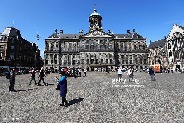 Tourists walk near the Royal Palace on May 11 2016 in Amsterdam Netherlands The Royal Palace or Koninklijk Paleis Amsterdam or Paleis op de Dam in...