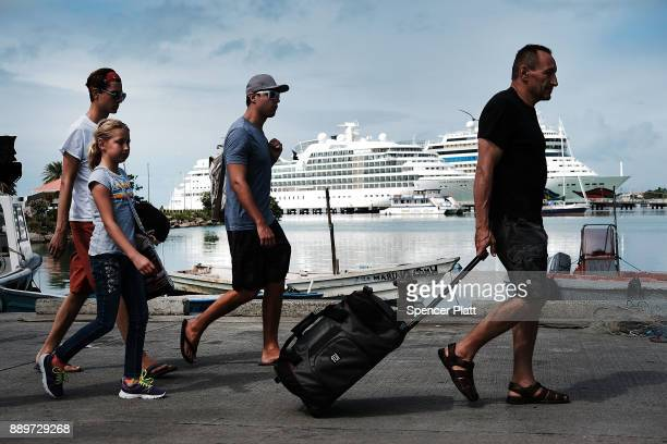 Tourists walk off of a cruise ship on December 10 2017 in St John's Antiqua While it's sister island Barbuda was nearly destroyed in Hurricane Irma...