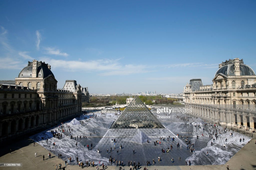 """""""JR Au Louvre & Le Secret De La Grande Pyramide"""" :JR Creates A Monumental Piece OF Art On The Scale Of Napoleon Court : Day 5 : News Photo"""