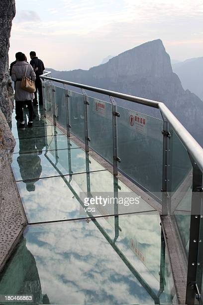 Tourists walk on a glass road alongside a cliff on Tianmen Mountain on November 9 2011 in Zhangjiajie Hunan Province of China The oriental 'Skywalk'...