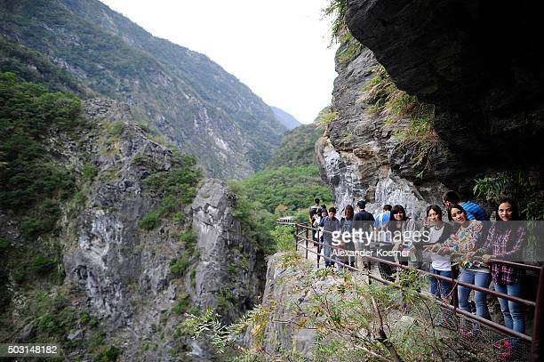Tourists walk on a trail towards Loushao at a canyon above the Leewo Ho River inside Taroko National Park on January 2, 2016 in Hualien, Taiwan. The...