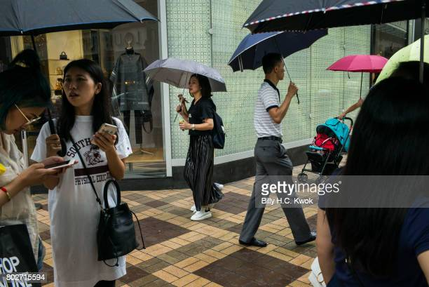 Tourists walk on Canton Road in the Tsim Sha Tsui area on June 18 2017 in Hong Kong Hong Kong Hong Kong is marking 20 years since the territory was...