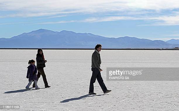 Tourists walk on July 12 2011 at Salinas Grandes one of Argentina's greatest depressions with an exposed surface of over 12000 hectares of salt at...