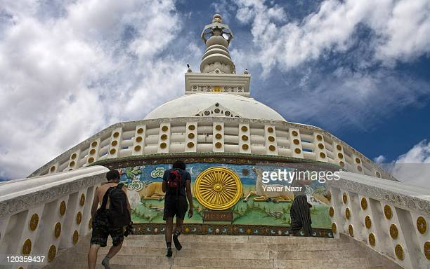 Tourists walk on the stairs of Shanti Stupa monastery on August 02 2011 in Leh east of Srinagar in Ladakh India Ladakh is a region within the...