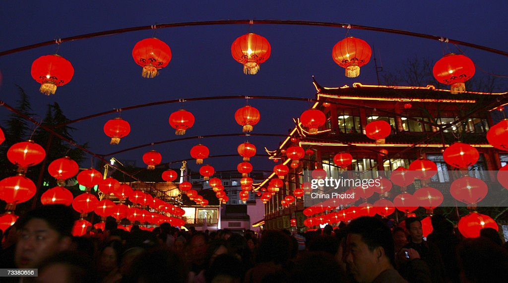 tourists walk on the wende bridge decorated with red lanterns during new year celebrations at the - Chinese New Year 2007