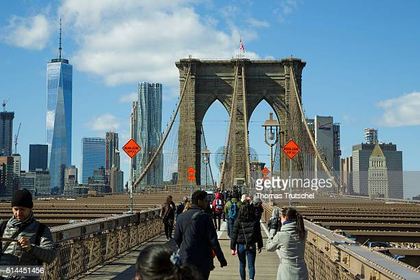 New York United States of America February 26 Tourists walk over the Brooklyn Bridge to lower Manhattan on February 26 2016 in New York United States...