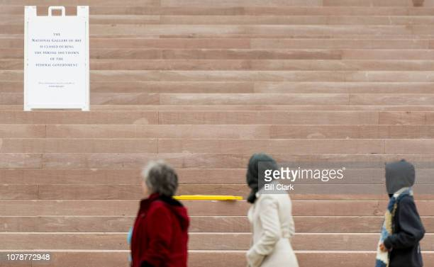 Tourists walk past a sign announces that the National Gallery of Art is closed due to the partial government shut down on Monday Jan 7 2019 The...