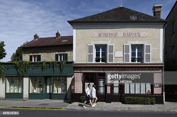 Tourists walk past the Auberge Ravoux also known as the House of Van Gogh in AuverssurOise in the northwestern suburbs of Paris on August 11 2015...