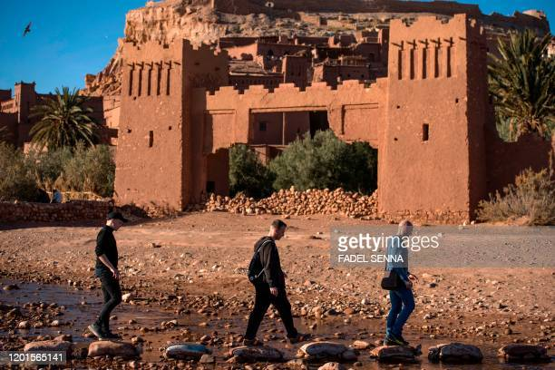 Tourists walk past the Kasbah of AitBenHaddou where scenes depicting the fictional city of Yunkai from the hit HBO television series Game of Thrones...