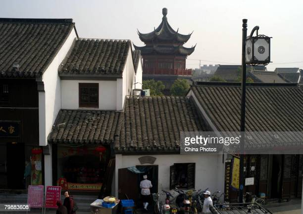 Tourists walk past traditional architectures at the Shantang Street at the old urban area of Suzhou on February 20 2008 in Suzhou of Jiangsu Province...