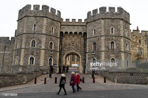 Tourists walk past Windsor Castle in Windsor, west of London on January 9, 2020. - Britain's Prince Harry and his wife Meghan stunned the British...