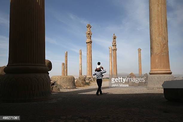 Tourists walk through the ancient Persepolis archeological site on May 30, 2014 in Persepolis, Iran. The ruins mark the site of the 6th century BC...