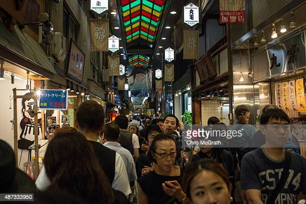 Tourists walk through the famous Nishiki Food Market on September 6 2015 in Kyoto Japan The famous city of Kyoto is going through a massive tourism...