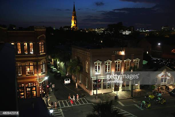Tourists walk through the historic district on July 15 2015 in Charleston South Carolina The second largest city in South Carolina Charleston is...