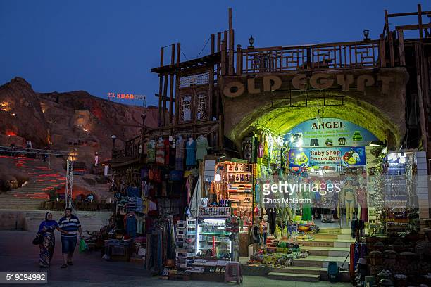 Tourists walk through the Old Market district on April 3 2016 in Sharm El Sheikh Egypt Prior to the Arab Spring in 2011 some 15million tourists would...