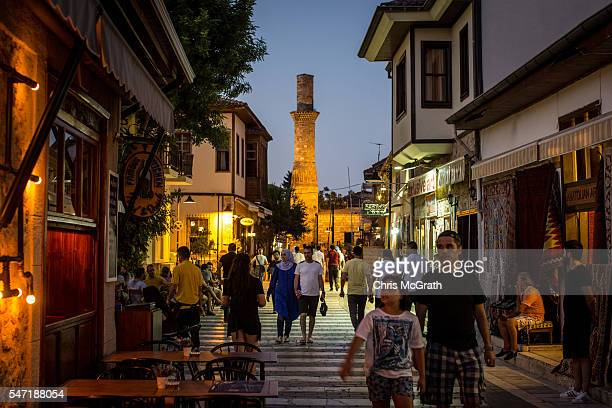 Tourists walk through the Old Town tourist district on July 13 2016 in Antalya Turkey Russian President Vladimir Putin last month officially lifted...