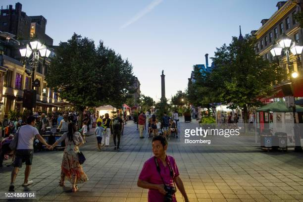 Tourists walk through the Place JacquesCartier in Montreal Quebec Canada on Sunday Aug 19 2018 Median singlefamily home prices in Montreal rose57%...